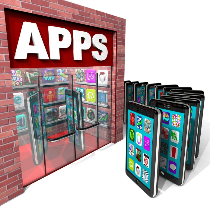 Many mobile smart phones line up to purchase applications at a store marked Apps symbolizing a computer based marketplace for downloadable software